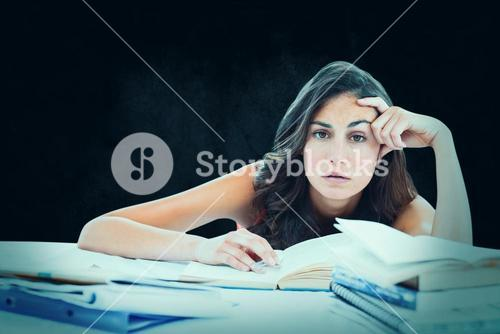 Composite image of bored student doing her homework