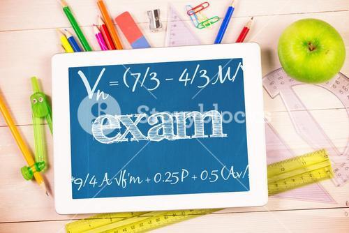Exam against students desk with tablet pc