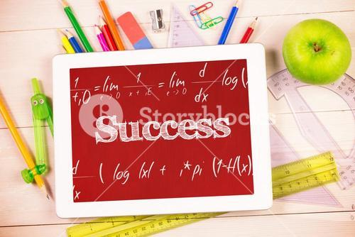 Success against students desk with tablet pc