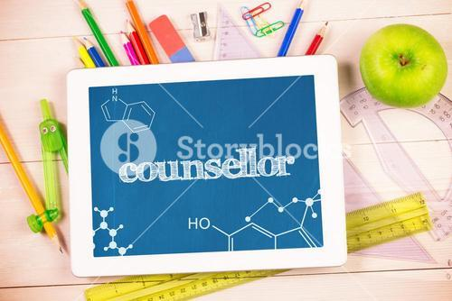 Counsellor against students desk with tablet pc