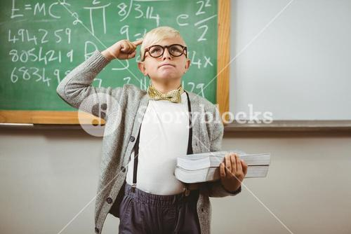 Pupil dressed up as teacher holding books