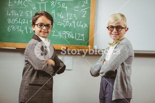 Smiling pupils dressed up as teachers in a classroom