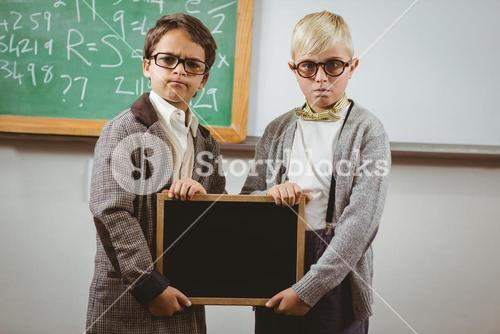 Pupils dressed up as teachers holding chalkboard