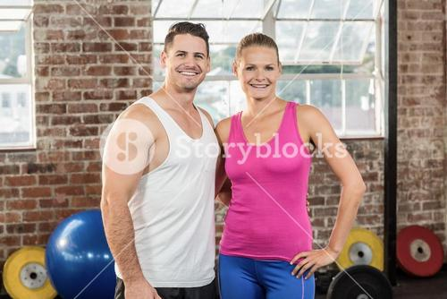 Crossfit couple smilling at the camera