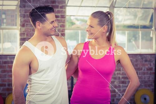 Fit smiling couple in crossfit
