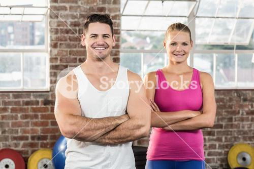 Portrait of smiling athletic couple