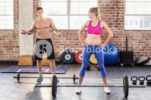 Two fit people working out