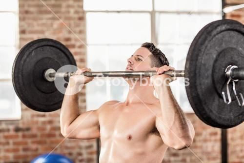 Muscular man doing weightlifting
