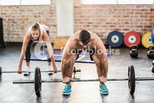 Two fit people working out at crossfit session
