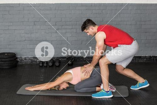 Muscular couple doing a body stretching