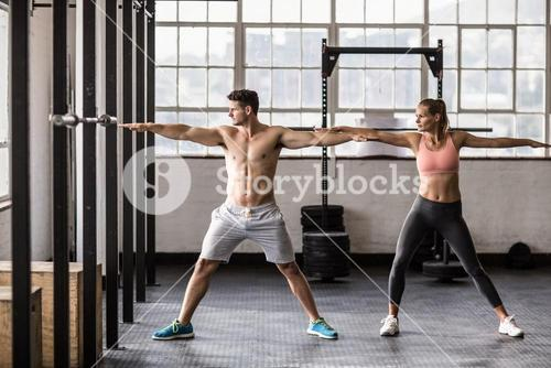 Two fit people doing fitness