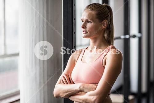 Muscular serious woman thinking