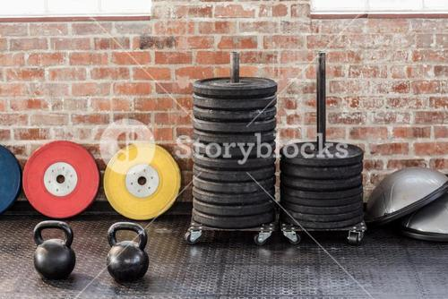 kettlebells in front of weights and bossu