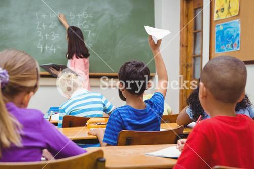 Student about to throw a paper airplane
