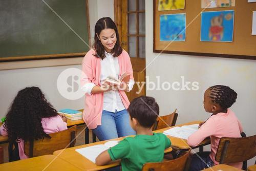 Teacher reading out loud to classroom