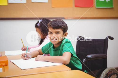 Smiling student sitting in wheelchair
