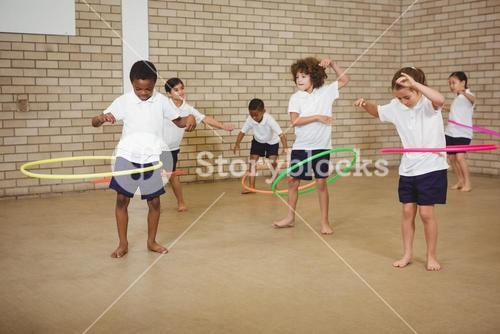 Students using some hula hoops