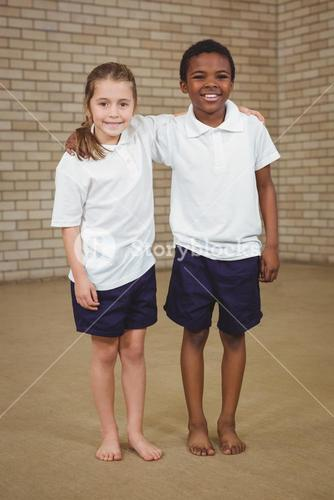 Pupils smiling with arms around each other