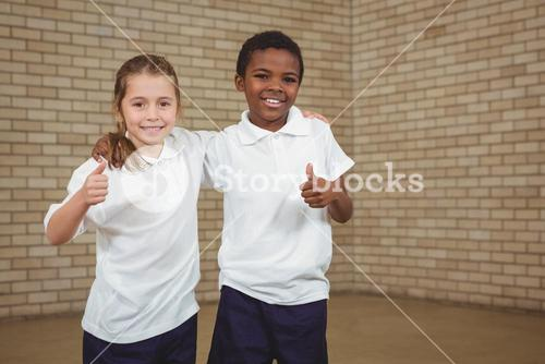 Smiling students with thumbs up