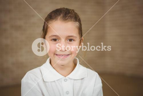 Happy pupil with folded arms