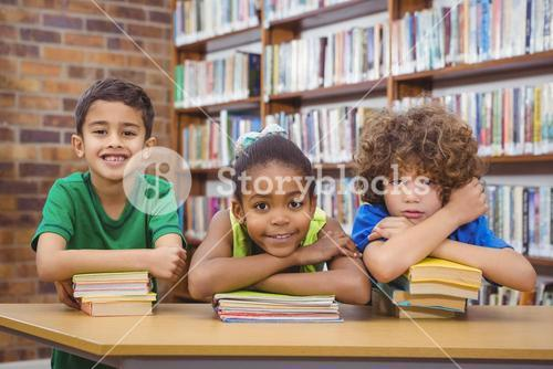 Students leaning upon school books