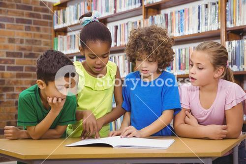 Students reading froma school book