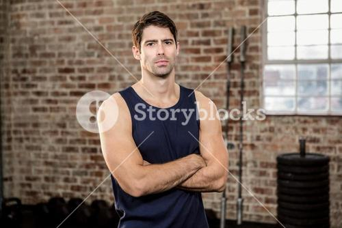 Serious man with arms crossed