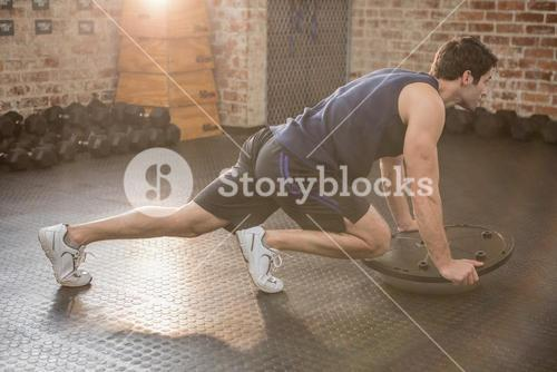 Man doing exercise with bosu ball