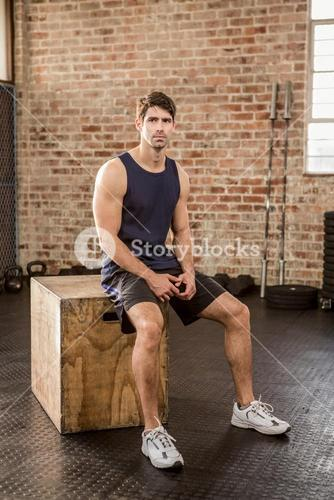 Man sitting on plyo box
