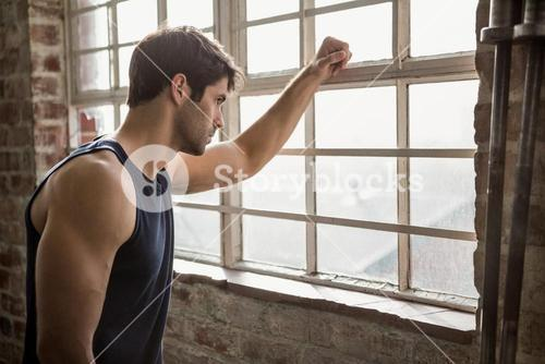 Man looking outside window