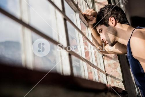 Man looking outside from window