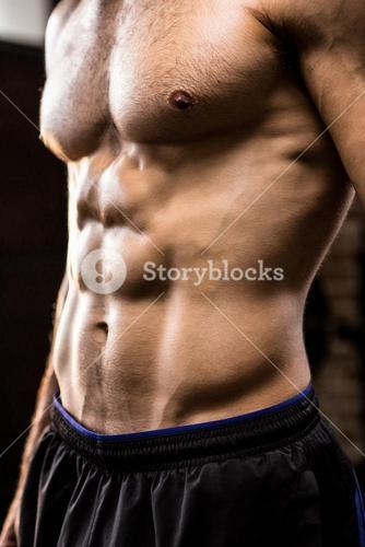 Midsection of man showing abs