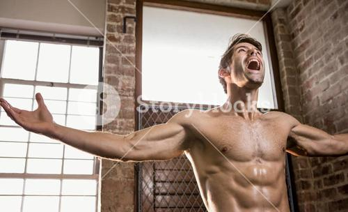 Muscular man with arms stretched