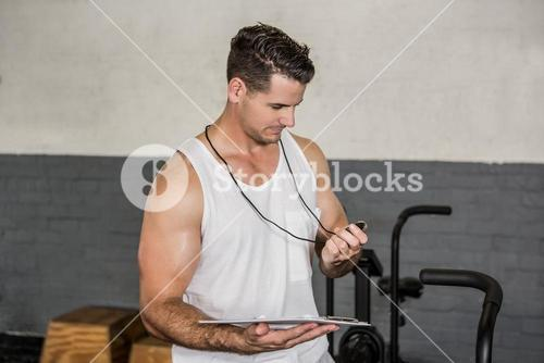 Instructor holding stopwatch and clipboard