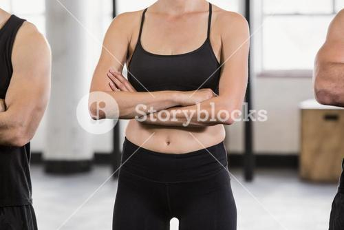 Midsection of a woman with arms crossed