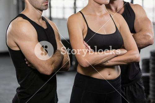 Midsection of people with arms crossed