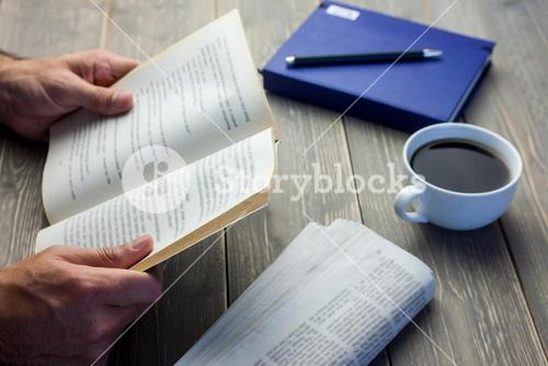 Person reading book at the desk