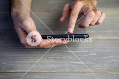 Person holding and using smart phone