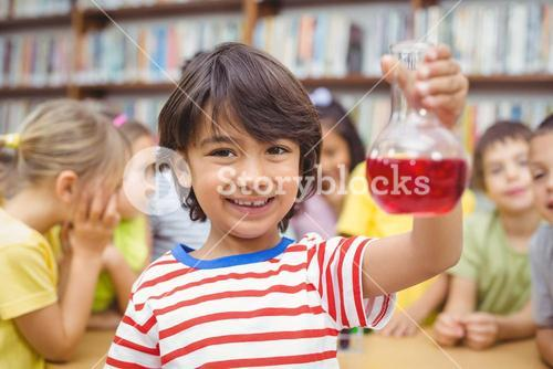 Pupil doing science in library