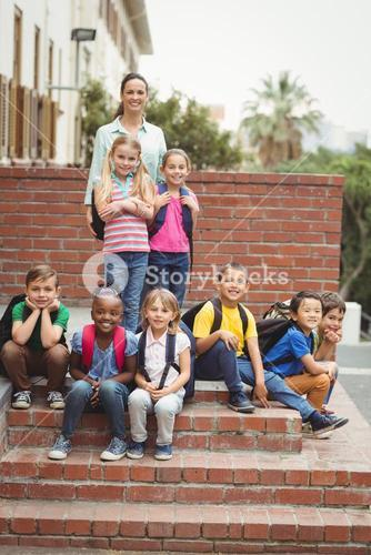 Cute pupils with teacher outside