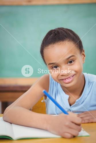 Smiling student working on school work