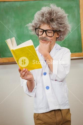 Student dressed up as einstein reading a book