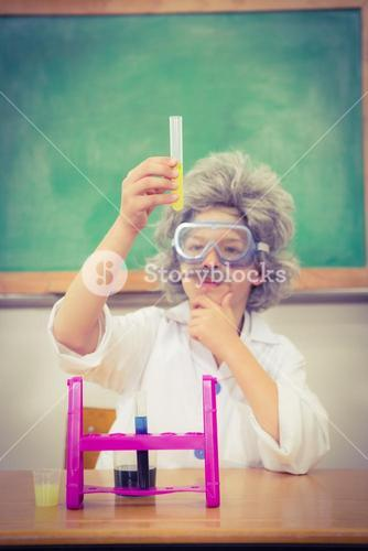 Student dressed up as einstein using a chemistry set