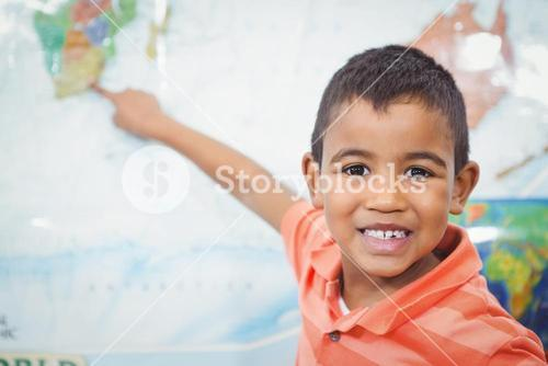 Student pointing to a map of the world