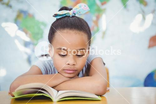 Student reading from a school book