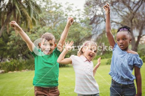 Kids celebrating with arms raised