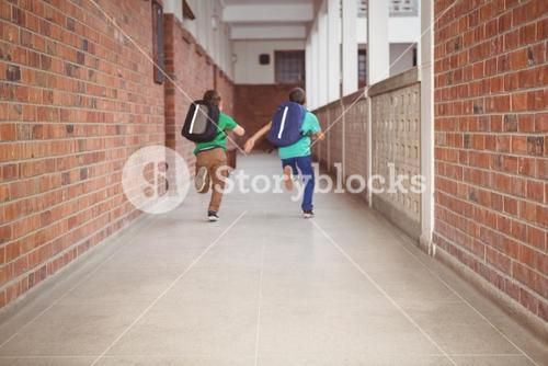 Students running down the school hall