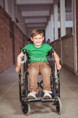 Smiling student in a wheelchair