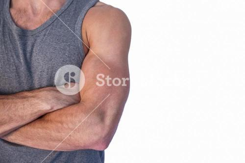 Muscular man with arms crossed