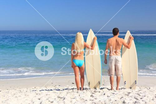 Couple with their surfboards